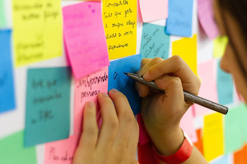 Sharing ideas on sticky notes on a wall