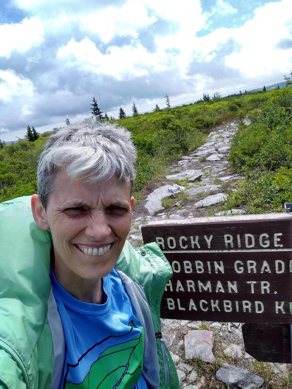 author enjoying time off on hiking trail