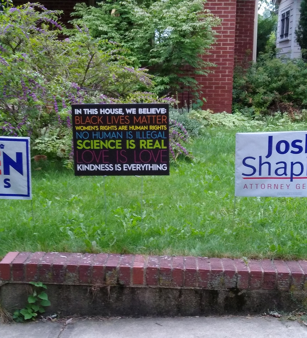 """Yard sign with statements listed under """"we believe"""""""