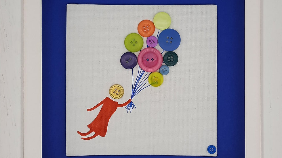 Female floating with balloons