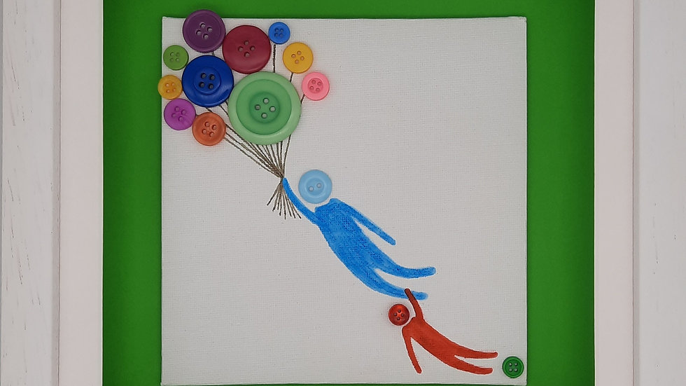 Person and child floating with balloons