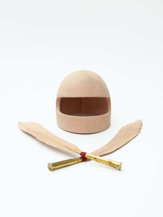 Wooden helmet with feathers