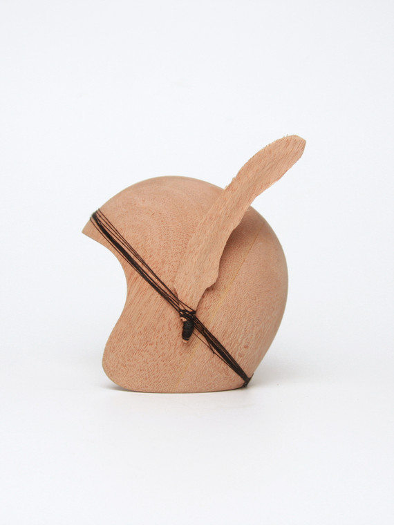 Wooden helmet with feather