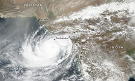 Figure 1: Cyclone Vayu making landfall over the India-Pakistan region, while the monsoon is progressing northward over the subcontinent.
