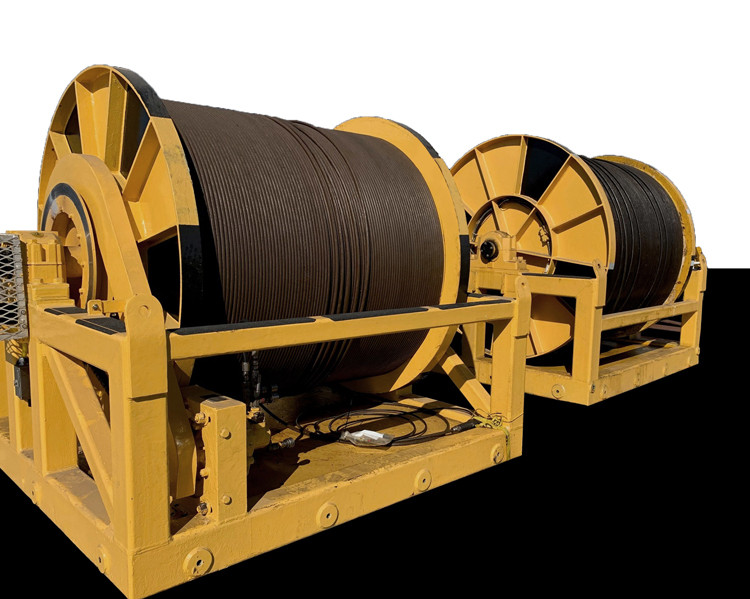 Figure 3: Two of three 34-ton storage winches with umbilicals, part of Global Oceans' deep-sea vehicle deployment support.