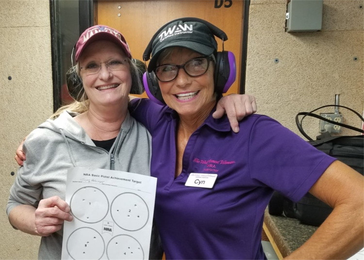 1st time shooter Joyce, was overcome with emotion, as she hit the center of target numerous times in a row! I love this picture!