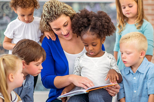 woman reading to grp of kids.jpg
