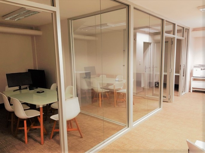 full height clear anodised glass walls & doors create an open fee to a smaller space