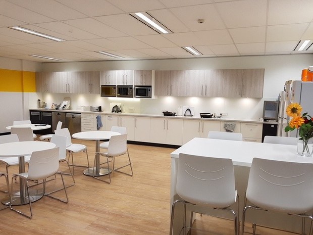 2. Client - Marten & Assoc:  very large lunch room with double size kitchen cabinetry, tea room furniture and vinyl flooring
