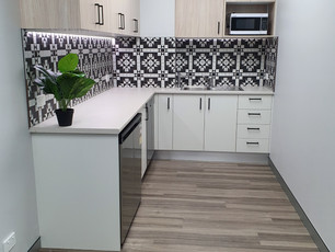 1. Eclipse Consulting Engineers: This is a compact but very functional kitchen with under bench fridge, dishwasher and plenty of storage. A stylish design with vinyl timber look flooring.