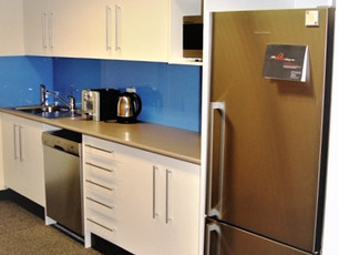 4. Client - Trapeze and Assoc: laminate kitchen with dishwasher opening glass splash back and overheads