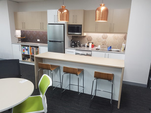 5. Form Office Interiors: our showroom kitchen with tiled splash back, laminate kitchen with overheads and island bench