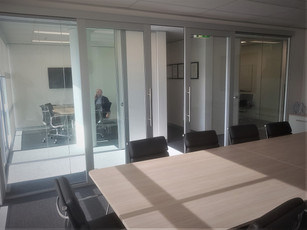 2.   Glass front meeting room with double aluminium and glass sliding doors