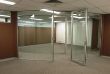 full height glass wall with aluminium framed glass door
