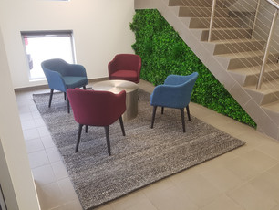 5. Artificial green walls can transform a vertical surface into a low maintenance, high impact piece of wall art.