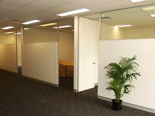 11.  2/3 solid, 1/3 glass office fronts with full height painted doors