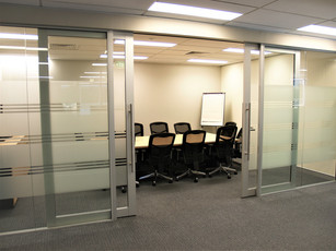 1.   Glass front meeting room with double aluminium and glass sliding doors