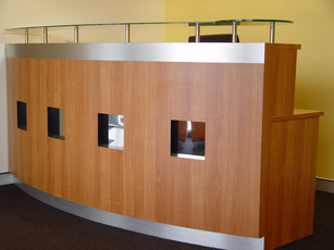 4. melamine counter with mirror insets, glass top and stainless steel detail