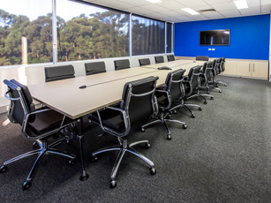 7. Client - Austdac: laminex melamine, rectangle boardroom table on chrome smooth base.