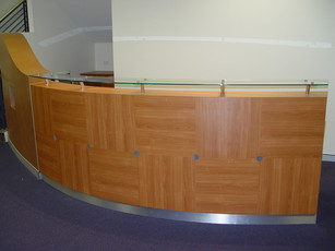 5. Client - Tiens: detailed curved melamine counter with glass hob and stainless steel skirting