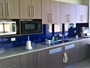3. Client - Reinforced Earth: large laminate kitchen with glass splash back, overhead with double microwave units