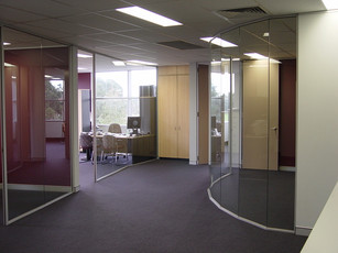 5.  Curved full height glass partitions