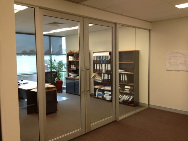 full height glass wall with double glass aluminium sliding doors