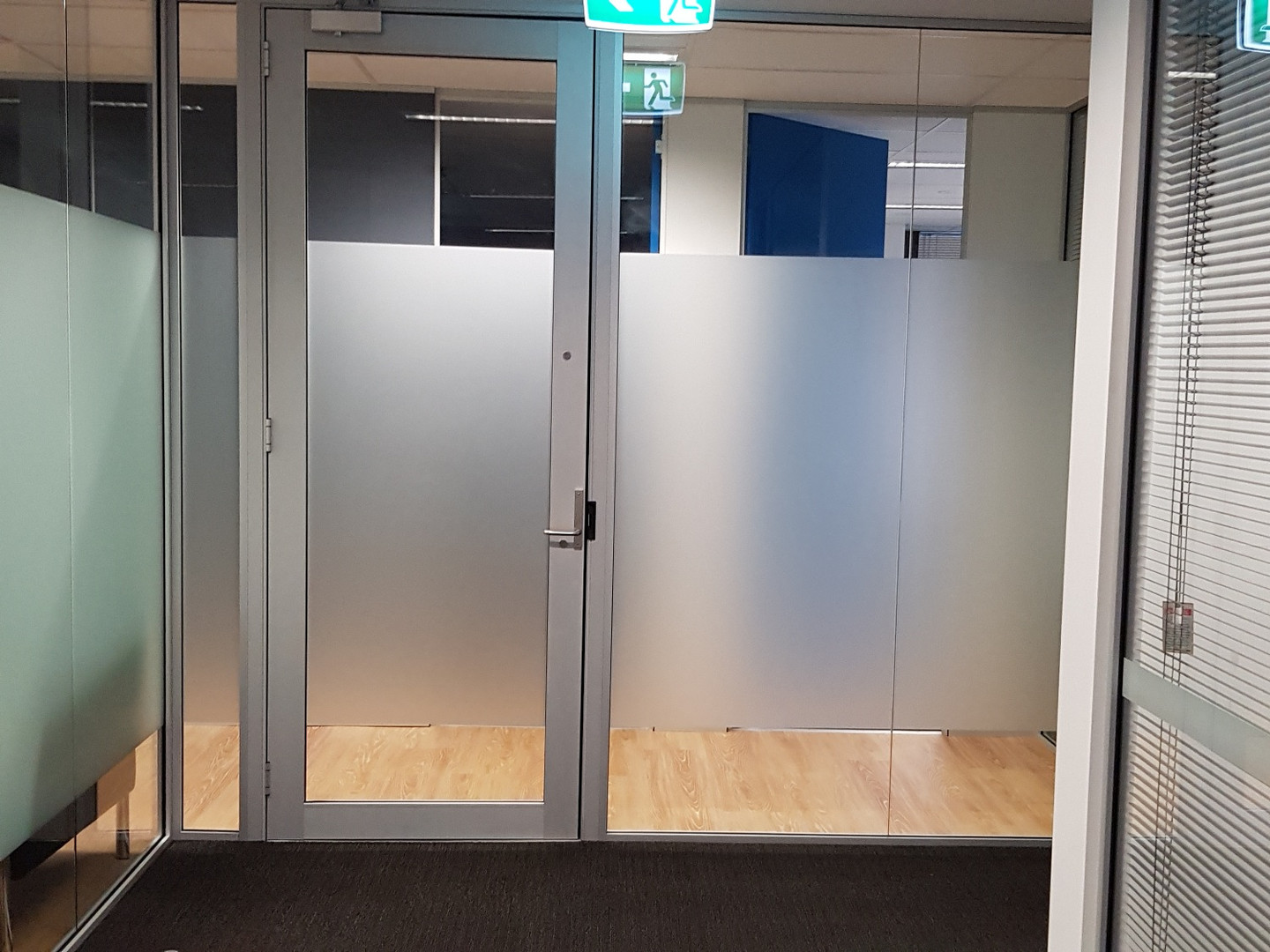 full height glass partition with aluminium framed glass door