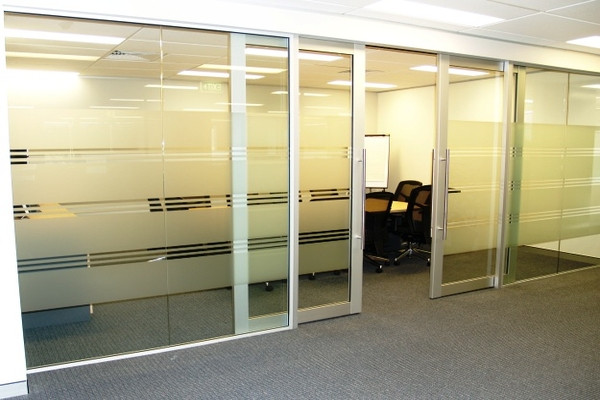 Glass front meeting room with double aluminium and glass sliding doors