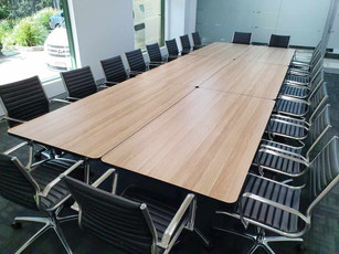 2. Alter Image Constructions - Soft padded Eames replica chairs surround mobile folding tables making up one larger meeting table