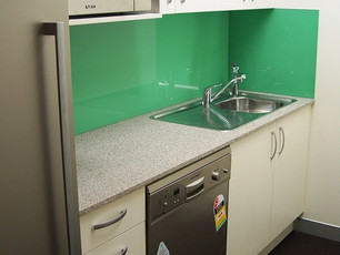 7. Client - MDA:  laminate and caesar stone kitchen with glass splash back, dishwasher opening and overheads