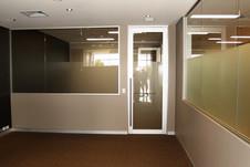 half glass wall with aluminium hinged glass door