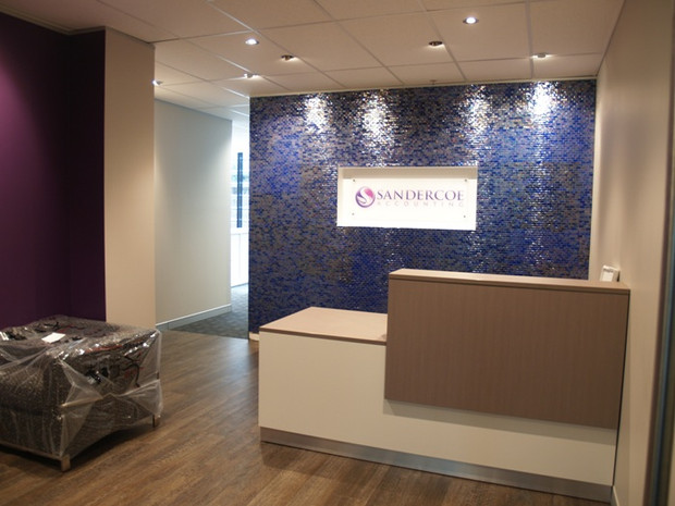 4. Mosaic ceramic tiles surround a corporate signage inset to create a striking entry.
