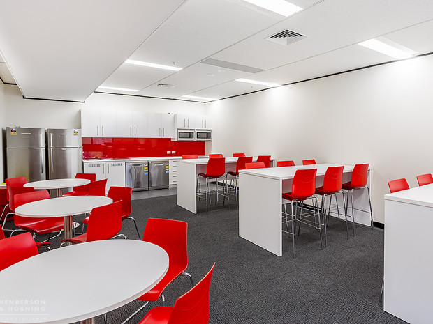 6. Client - Geeks 2 U: very large lunch room with tall benches and low round tables, laminate kitchen with glass splash back, double dishwasher and microwaves