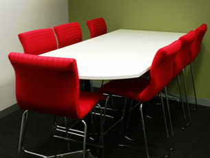 9. Client - Toyota Finance: tall meeting tables finished in laminex melamine with chrome base and stools