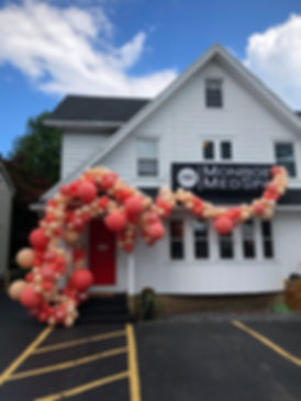 Monoroe Medspa Exterior with balloons, medical spa rochester NY
