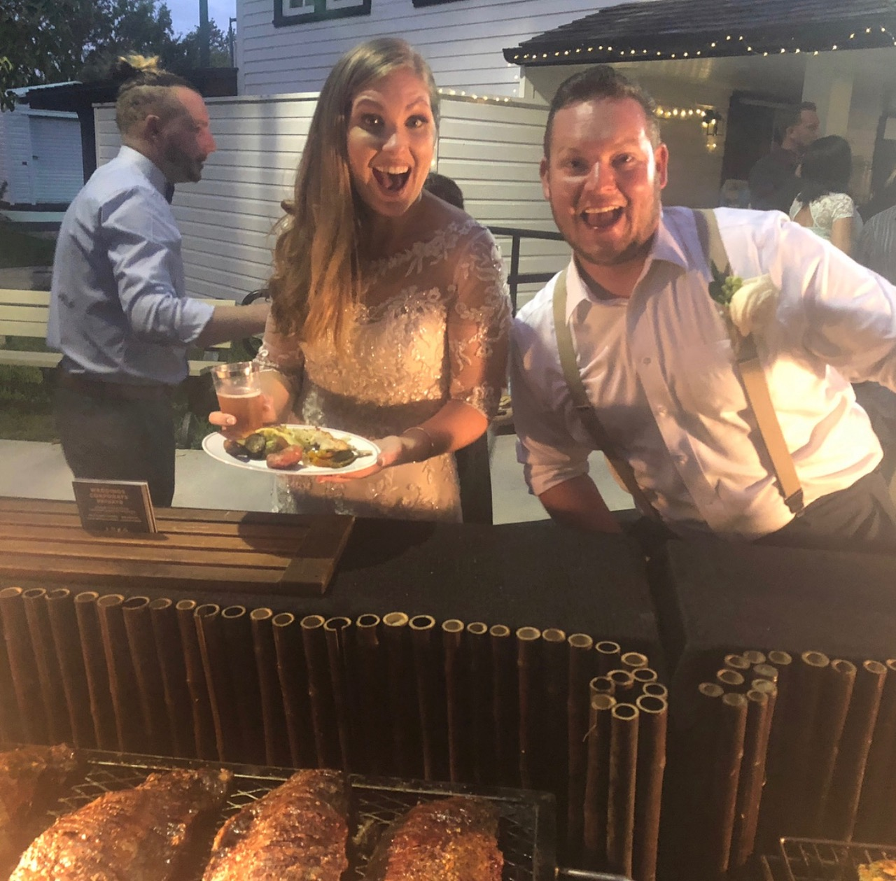 Happy bride and groom loving their steak dinner by Yummy Chori