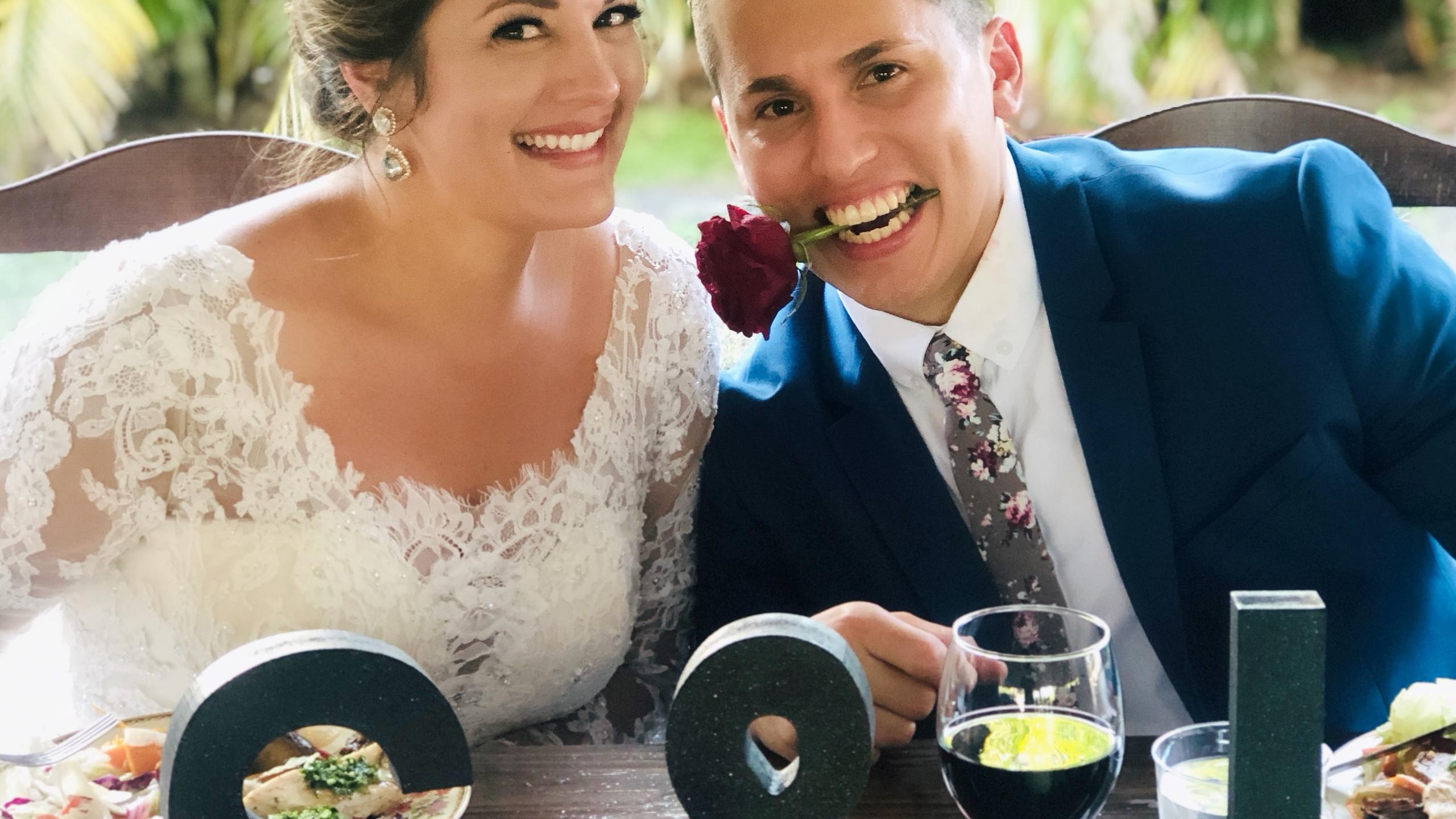 Happy couple enjoying their wedding dinner by Yummy Chori.