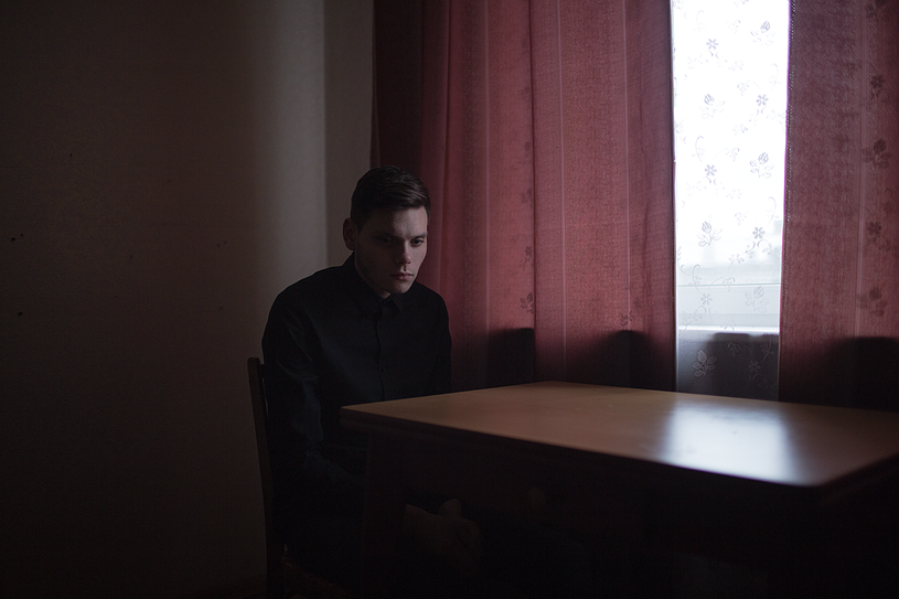 """Georgiy, 22 years old, poses for a portrait at his apartment in St. Petersburg, Russia.    Georgiy says: """"One of the reasons for moving to St. Petersburg is a desire to live openly in a big city. If you had asked me before moving if I was gay — I would have said """"no""""."""