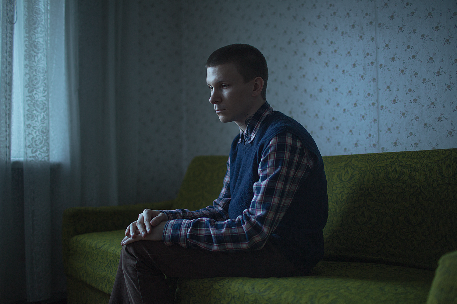 """Anton, 20 years old, poses for a portrait at his apartment in St. Petersburg, Russia.     Anton says: """"Heterosexuality is the right thing, everything else is not. I hope I'm not gay forever."""""""