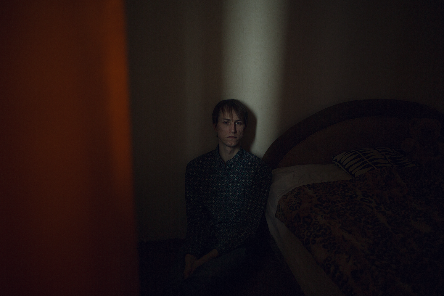 """Maxim, 28 years old, poses for a portrait at his apartment in St. Petersburg, Russia.   Maxim says: """"Sometime later my mom confessed: """"Every day I lived with the thought that my son was gay and I was looking for any excuse to make a scene. Then I imagined how during an argument I was taking an axe and cutting your head off. I really wanted it."""""""