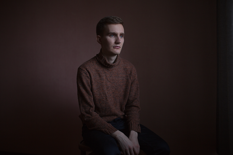 """Sergey, 23 years old, poses for a portrait at his apartment in St. Petersburg, Russia.   Sergey says: """"I'm trying to prepare myself for loneliness, I don't cherish any illusions about surrogate mothers and mythical children that gays can adopt. I picture a scenario where there is no one to bury me."""""""