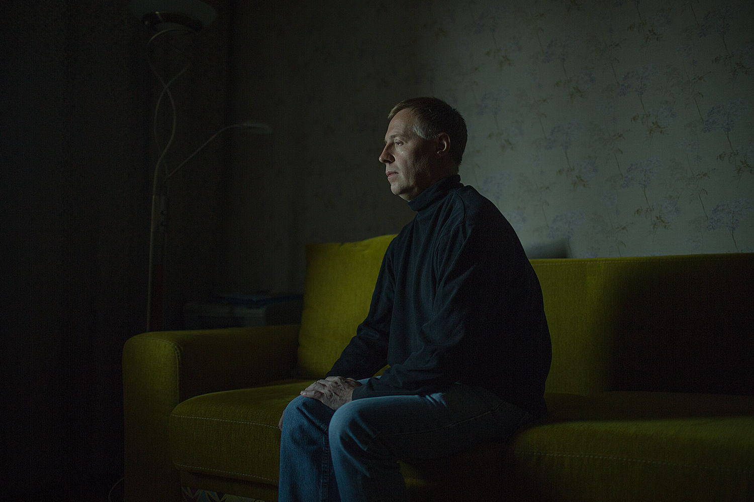 """Alexander, 45 years old, poses at his apartment in St. Petersburg, Russia.   Alexander says: """"I used to work in the criminal investigations department. You know how it happens, the colleagues say """"Let's go to the steam bath, let's invite girls."""" I answered """"No thanks. I gotta go,"""" and people started to ask questions. Then they began to say to my face directly """"What a police officer you are…"""" I had to leave my job because of this discrepancy. I mean, not because of a professional discrepancy."""""""