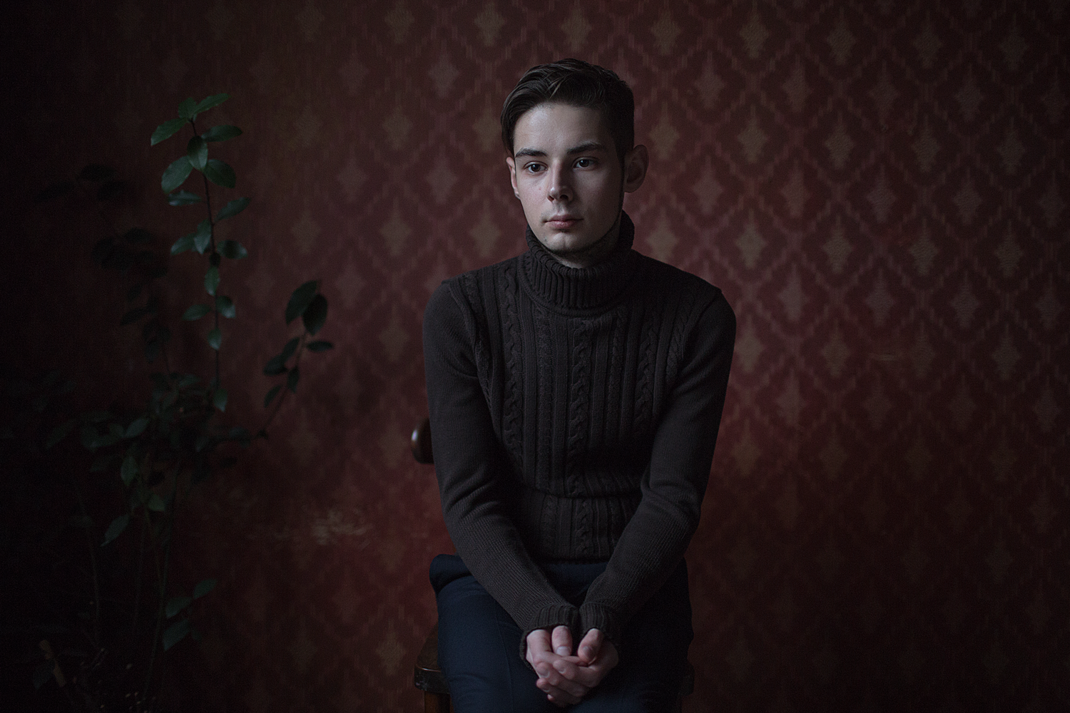 """Ivan, 24 years old, poses for a portrait at his apartment in St. Petersburg, Russia.  Ivan says: """"The meaning of life is to live your own life. Not someone else's, not illusory, but full. To breathe with two lungs instead of one and say """"I don't need my second lung."""""""