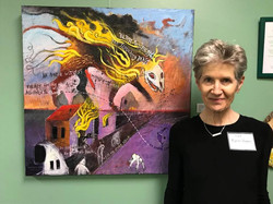 Karen Hayes in front of her collaboration with Dominique Simmons, Photo Courtesy of Kai Coggin