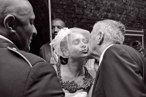 001 Father Kissing Bride at Wedding Phot