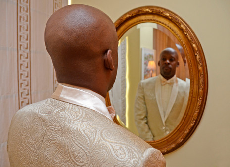 015B Groom in Mirror Before Wedding Cere
