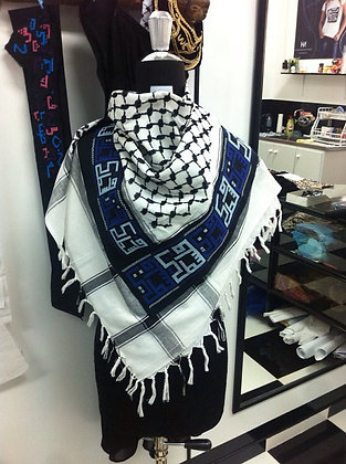 "Embroidered keffyeh with the word  ""palestine"""