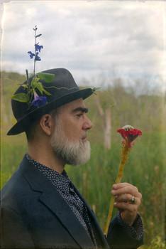 Portrait of Fredo Viola in hat, by Nicholas Kahn
