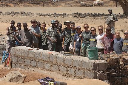 Gap year team and career break volunteers building dam, Marsabit, Kenya